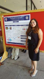 Tatiana presenting a poster.
